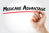 Hand writing Medicare Advantage with marker, concept background - 156999380
