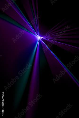 Laser beam purple on a black background - 157006168