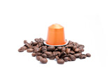 coffee capsule with coffee beans on white background