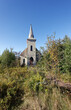 Abandoned church in overgrown field on Prince Edward Island, Canada. Vertical.