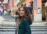 Beautiful young woman taking photo in Bellagio town, Como Lake, Italy  - 157073138