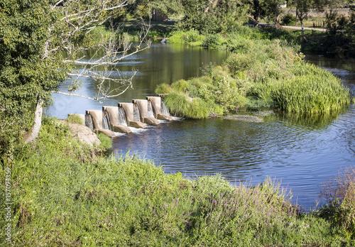 Aluminium Rio de Janeiro a small dam in River Umia in Caldas de Reis, province of Pontevedra, Galicia, Spain