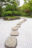 Zen stone path at Japanese green garden in summer