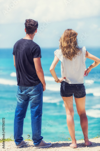 Couple enjoying the view on a tropical beach. Poster