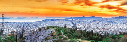 Papiers peints Athenes Athens, panoramic view from above. Sunset scenery with glowing orange dramatic sky, view from above. Athens is ancient city and the capital of Greece, Europe Union country.