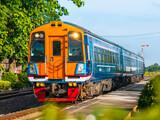 Diesel railcars was passing rural station, 2016. (Taken form public platform.)
