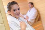 Woman in robe in doorway of sauna - 157150966
