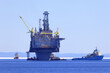 offshore oil and gas platform with supply ships