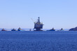 Oil and gas rig with supply ships