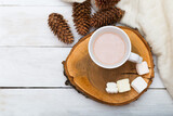 hygge. Cup with hot chocolate and marshmallows on a wooden tray
