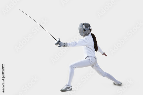 Female fencer isolated on white background Poster