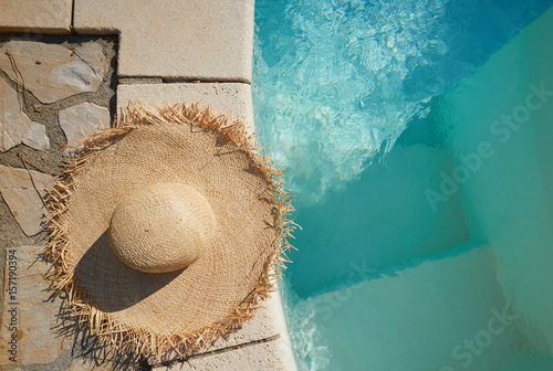 hat by a swimming pool. Background concept Poster