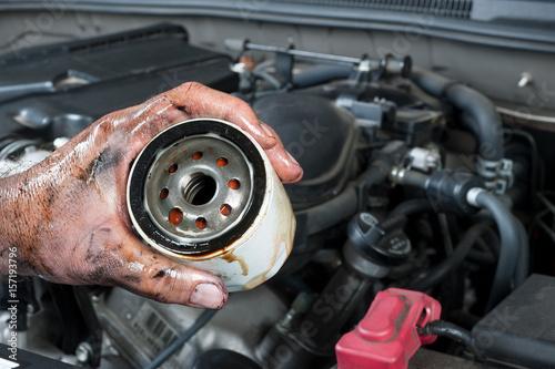 obraz PCV Auto mechanic holding oil filter