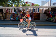 Woman riding bike in Mexican town