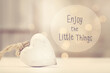 Enjoy The Little Things message with a white heart