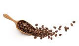 Coffee beans on wooden scoop isolated on white background