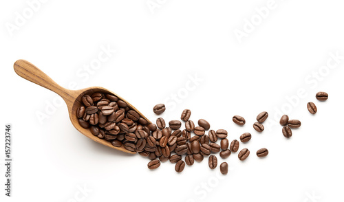Wall mural Coffee beans on wooden scoop isolated on white background