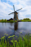 Traditional Dutch windmill on the canal bank in Kinderdijk Netherlands