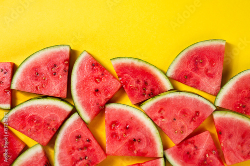 Beautiful pattern with fresh watermelon slices on yellow bright background. Top View. Copy Space. - 157245101