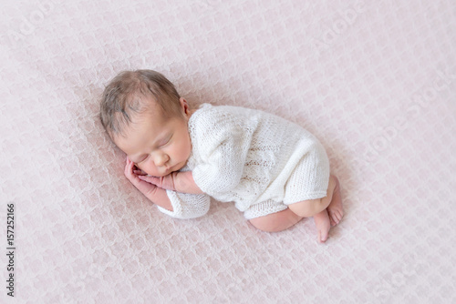 newborn sleeping on side, hands under cheek Poster