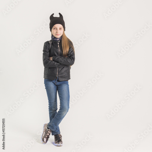 Poster Fashionable teen girl in black jacket