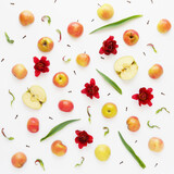 Fruit pattern of apples on a white background. Food background. Composition of fruits and flowers.