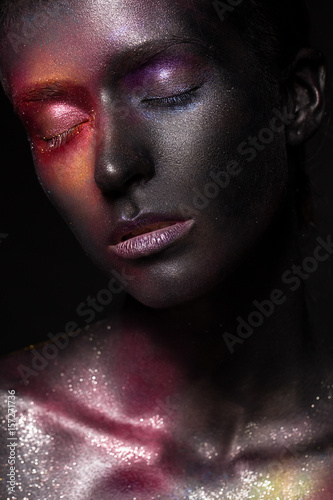 Beautiful girl with art space makeup on her face and body. Glitter Face. Photo taken in the studio. - 157271736