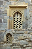Arched windows in stone wall of an old mosque, Baku, Azerbaijan