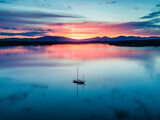 Aerial of an amazing sunset with sailing vessel Loch Creran, Barcaldine, Argyll