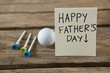 Close up of fathers day message with golf ball and tee