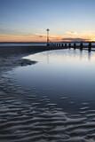 Beautiful vibrant Spring sunset long exposure beach landscape