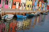 reflection on the water of the colorful houses of the island of