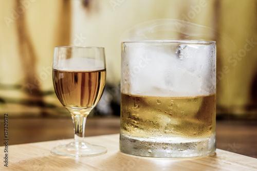Whiskey shot glass & full tumbler with smoke & ice Poster