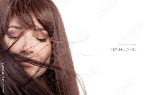 Beauty model with healthy long hair blowing over face