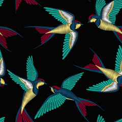Embroidery seamless pattern with beautiful swallow birds. Vector embroidery for fashion textile and fabric. © Alina