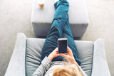 Person relaxing and using smart phone - 157348144