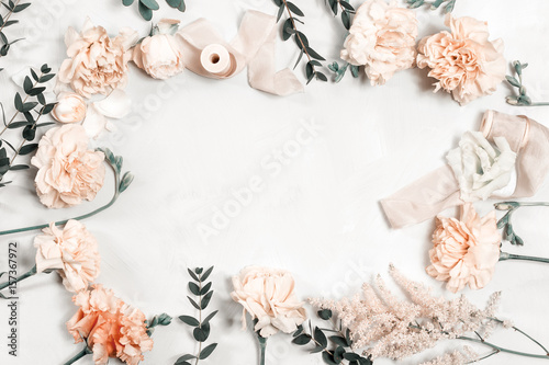 Staande foto Roses The florist desktop with working tools on white wooden background. copy space