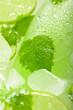 Leinwandbild Motiv A bottle of lemonade with lime and mint on ice