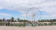 Landscape of Tuileries garden with Ferris wheel in Paris, France. Tuileries Garden is a public garden located between Louvre Museum and Place de la Concorde