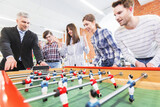 People playing table soccer