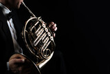 French horn instrument. Player hands playing horn music instrument - 157416396