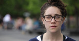 Caucasian woman in city park face portrait - 157420915