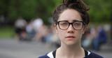 Caucasian woman in city park face portrait - 157420932