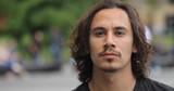 Young caucasian man in city park face portrait - 157420941