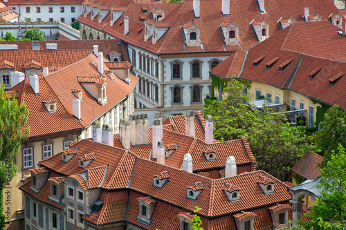 Poster Houses with traditional red roofs and trees in Prague Mala Strana district in th