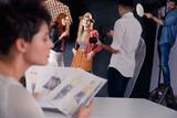 Fototapeta Fashion models talking with photographer