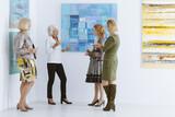 Friends meeting in museum - 157443951
