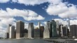 Time lapse! Fluffy clouds over financial district, Manhattan Island, New York City. Seen from Brooklyn