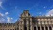 Photo of iconic Louvre Palace on a cloudy spring morning, Paris, France