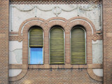 Three windows on the wall of old building